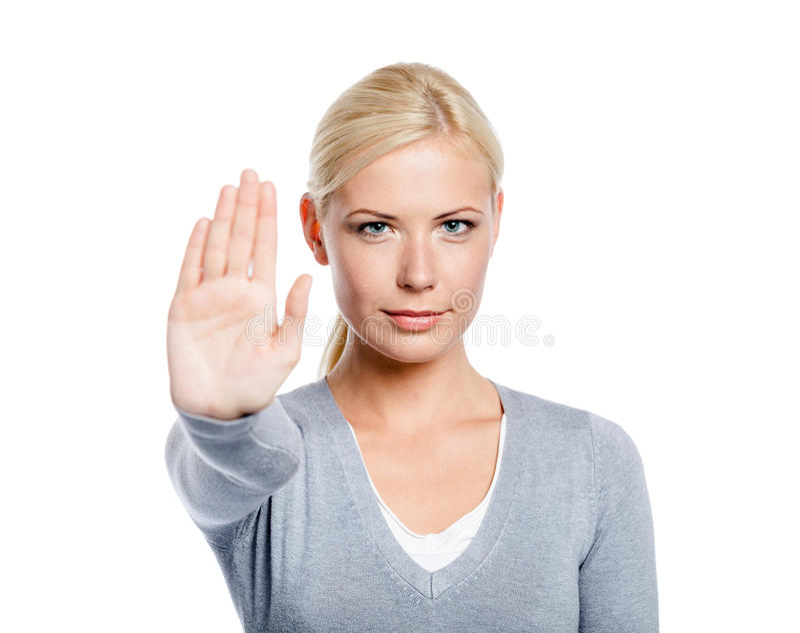 Madame effectuant le geste d'arrêt photo libre de droits