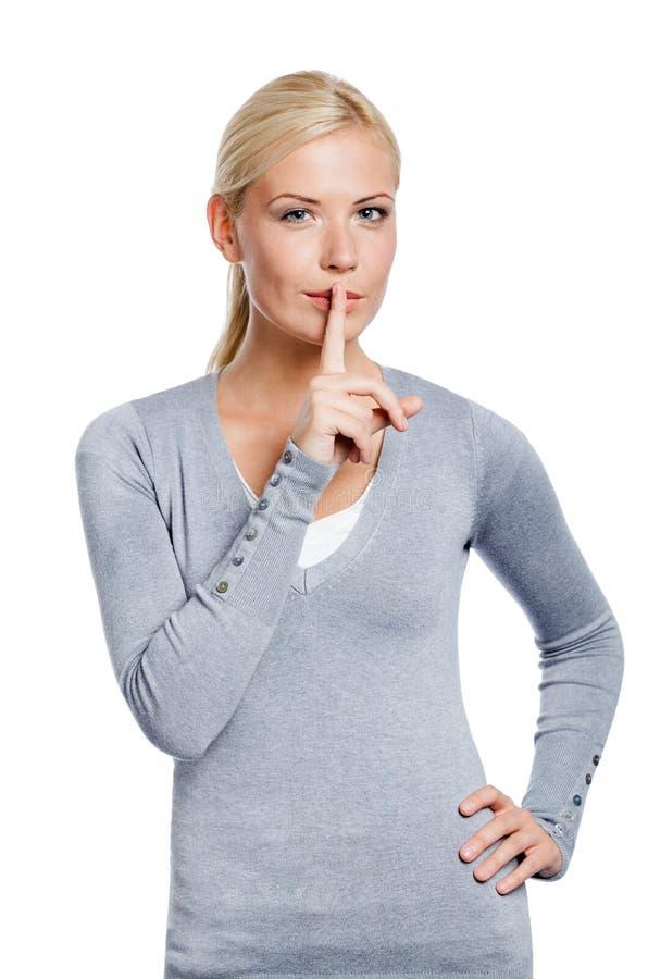 Madame faisant le geste de silence images stock