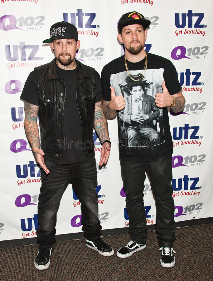 The Madden Brothers Perform at Q102 in Bala Cynwyd, PA, USA. Bala Cynwyd, PA, USA. 21st August, 2014. (L to R) Benji Madden and Joel Madden of American Pop Rock royalty free stock photo