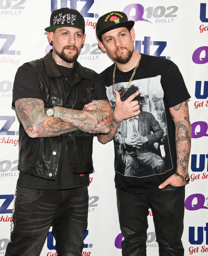 The Madden Brothers Perform at Q102 in Bala Cynwyd, PA, USA. Bala Cynwyd, PA, USA. 21st August, 2014. (L to R) Benji Madden and Joel Madden of American Pop Rock royalty free stock images