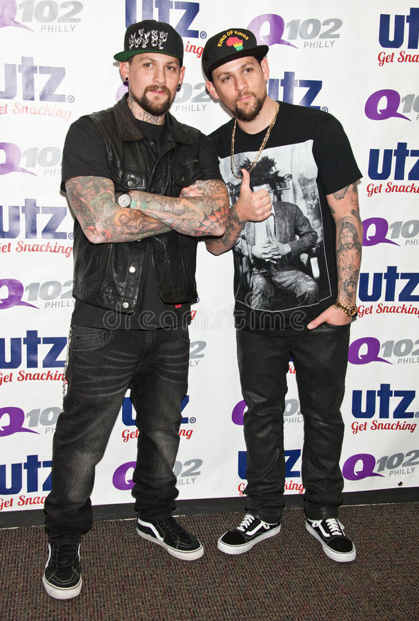 The Madden Brothers Perform at Q102 in Bala Cynwyd, PA, USA. Bala Cynwyd, PA, USA. 21st August, 2014. (L to R) Benji Madden and Joel Madden of American Pop Rock stock photography