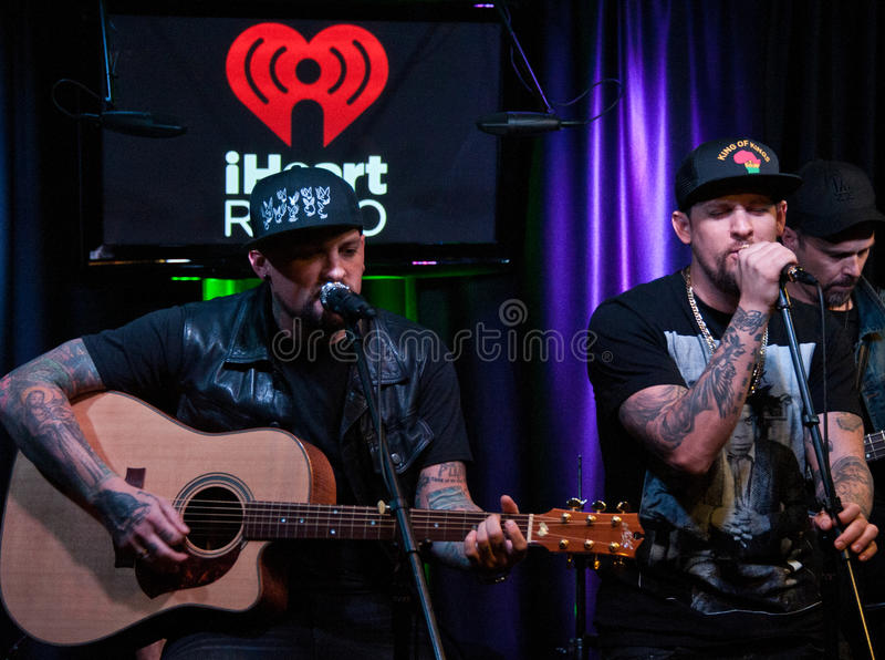 The Madden Brothers Perform at Q102 in Bala Cynwyd, PA, USA. Bala Cynwyd, PA, USA. 21st August, 2014. (L to R) Benji Madden and Joel Madden of American Pop Rock stock photo