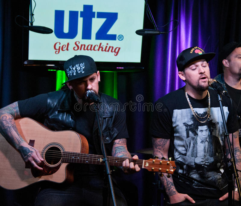 The Madden Brothers Perform at Q102 in Bala Cynwyd, PA, USA. Bala Cynwyd, PA, USA. 21st August, 2014. (L to R) Benji Madden and Joel Madden of American Pop Rock stock image
