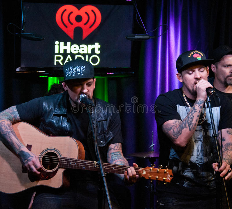 The Madden Brothers Perform at Q102 in Bala Cynwyd, PA, USA. Bala Cynwyd, PA, USA. 21st August, 2014. (L to R) Benji Madden and Joel Madden of American Pop Rock royalty free stock image