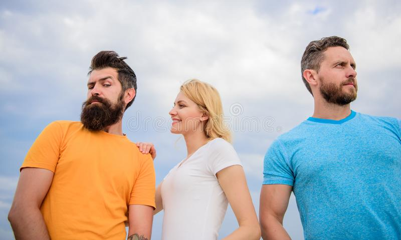 She made her choice. Girl decided with whom dating. Start romantic relationships. Girl stand between two men. Woman. Picked boyfriend. Love as competition royalty free stock images