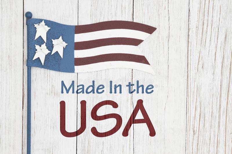 Made in the USA sign with flag. Made in the USA  sign with retro USA flag on weathered whitewashed textured wood royalty free illustration