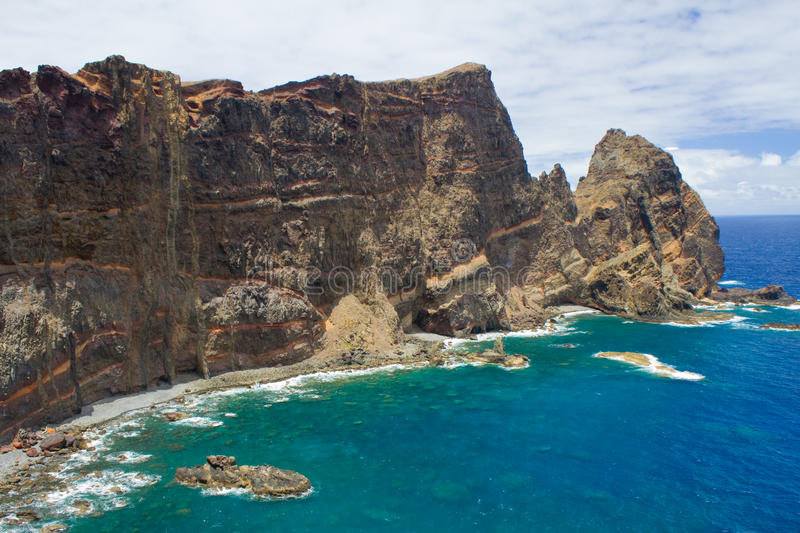 Madeira cliff with dykes. Cliff located in Madeira showing geological evidence of dykes and sills royalty free stock photography