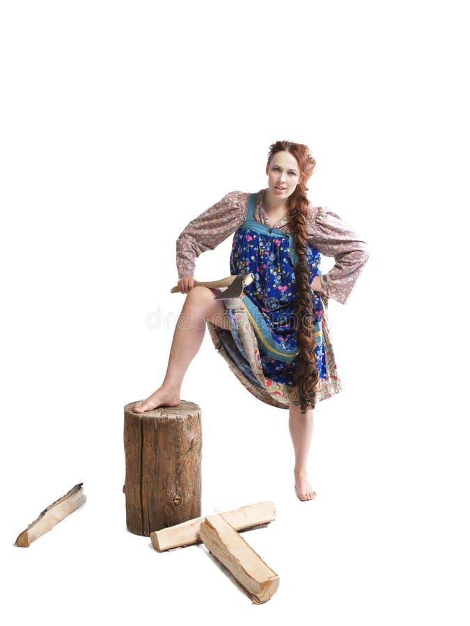 Madeira de desbastamento e de rachadura da mulher imagem de stock