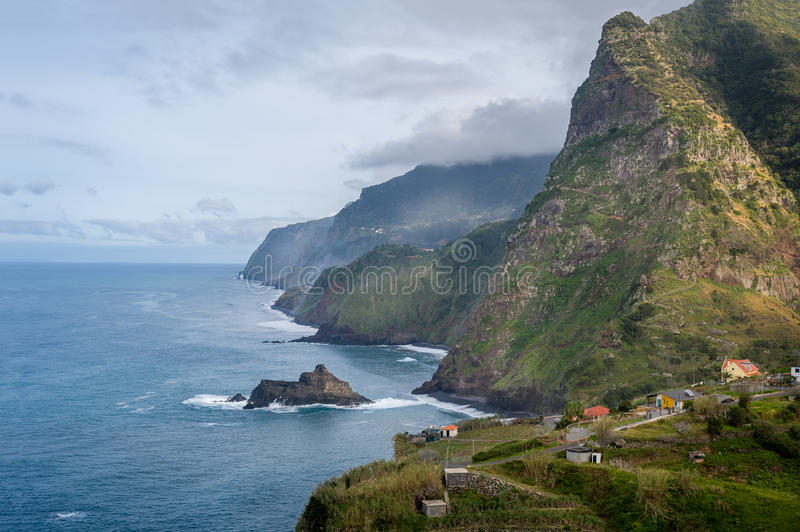 Madeira island north coast. Small village under rocky mountains and Atlantic ocean view stock photos