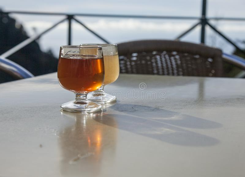 Madeira, Portugal - the city of Funchal, glasses with traditional liquor. This image shows a view of the city of Funchal in Madeira, Portugal. It was taken on a stock photo