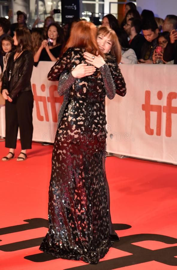 Madeline Brewer and Director Lorene Scafaria hugging at the premiere of Hustlers movie at Toronto International Film Festival stock image