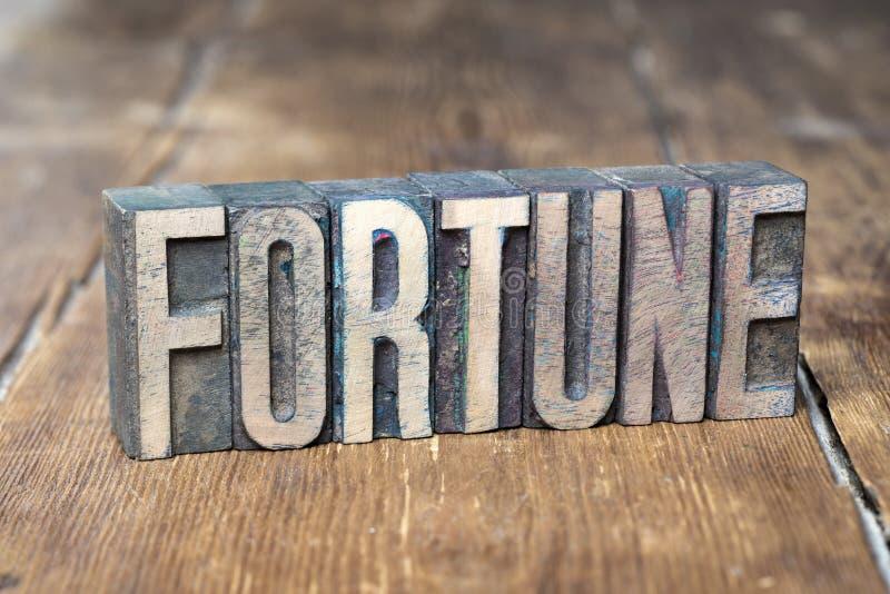 Madera de la palabra de la fortuna fotografía de archivo