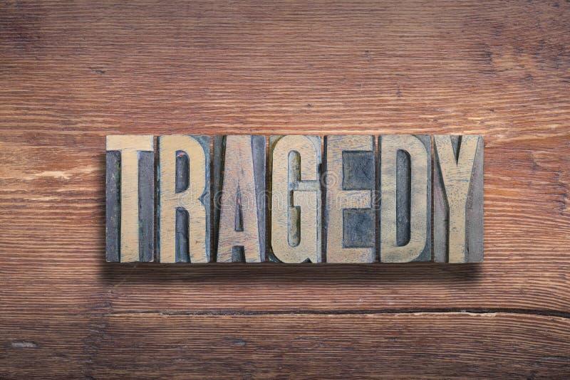 Madera de la palabra de la tragedia imagen de archivo libre de regalías