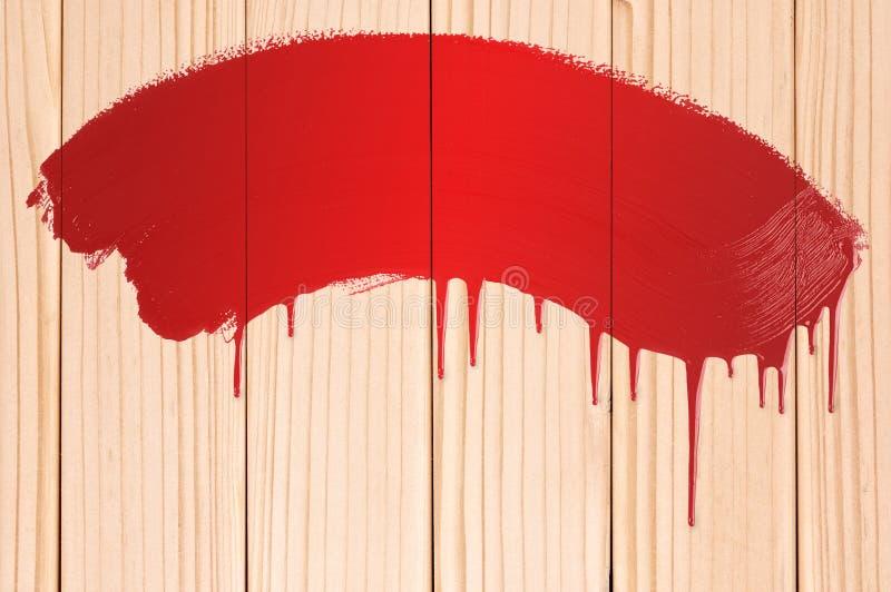Madera pintada roja foto de archivo