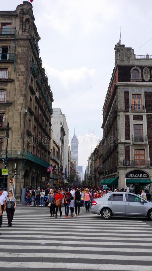 Madero street. Shot of the famous madero street in the center of mexico city, at the bottom can see the latinoamericana tower, a big famous building of the royalty free stock photography