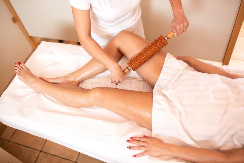Maderotherapy on a pair of sexy legs. Anti-cellulite therapy stock photography