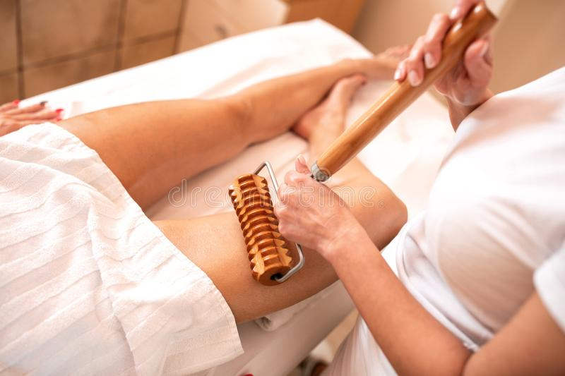 Maderotherapy and thigh massage, anti-cellulite treatment royalty free stock photography