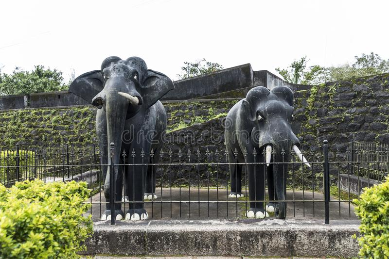 Two life size masonry black stone elephants sculpture inside Madikeri Fort in Coorg Karnataka India. Madikeri Fort was first founded by Mudduraja in the second royalty free stock images