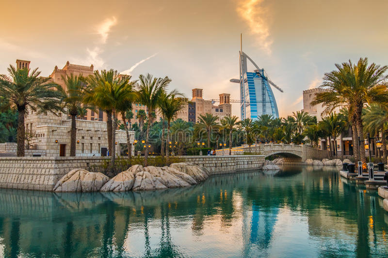 Madinat Souk. Dubai, UAE - March 29, 2015: View on Burj Al Arab from Madinat Jumeirah during sunset. Madinat is a luxury resort which include hotels and souk royalty free stock photos