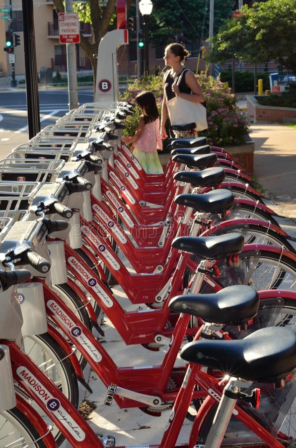 Madison Red Bikes. The Red Bikes Project started in 1996 with the intent of making bicycle transportation on Madison's isthmus free for all. The Budget stock photos