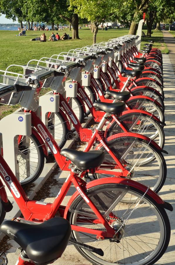 Madison Red Bikes. The Red Bikes Project started in 1996 with the intent of making bicycle transportation on Madison's isthmus free for all. The Budget royalty free stock photos