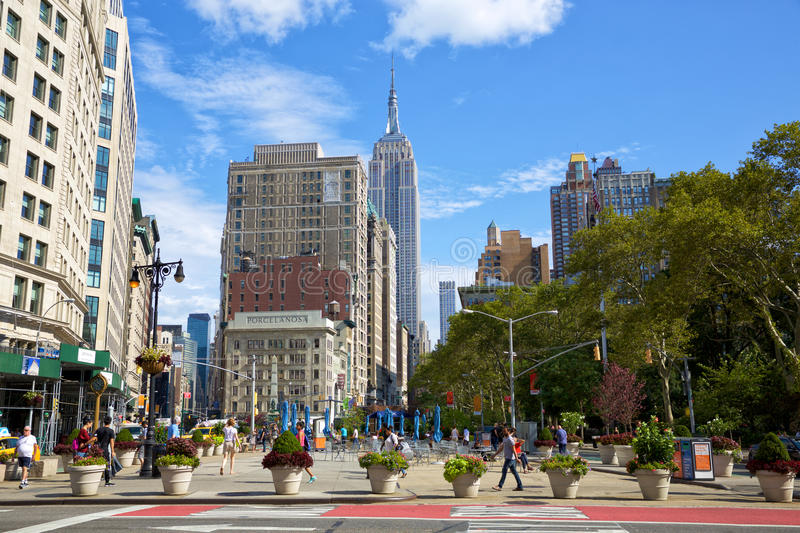 Madison Square Park and Broadway. New York, New York, USA - September 11, 2016: Madison Square Park and intersection Broadway and 5th Avenue with pedestrians stock photos