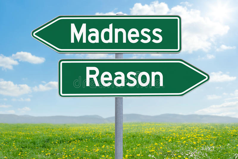 Madness or Reason. Two green direction signs - Madness or Reason stock photo