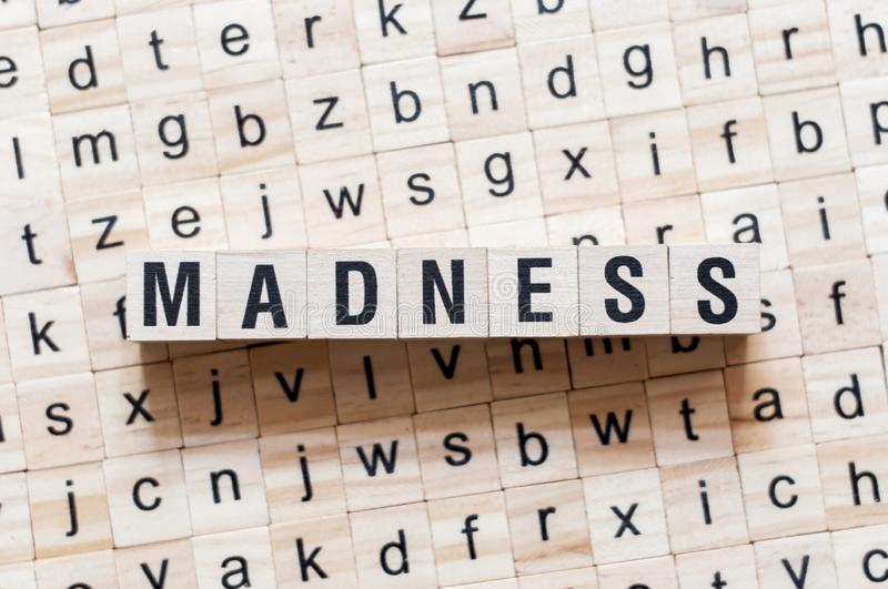 Madness word concept on cubes.  stock photography