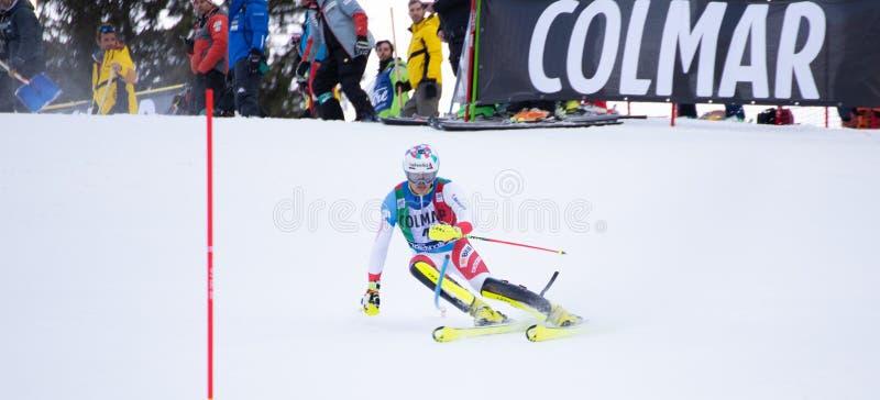 Madonna di Campiglio, Itália 12/22/2018 o slalom dos ?ns homens Daniel Yule de Suíça durante o slalom especial do campeonato do m fotos de stock