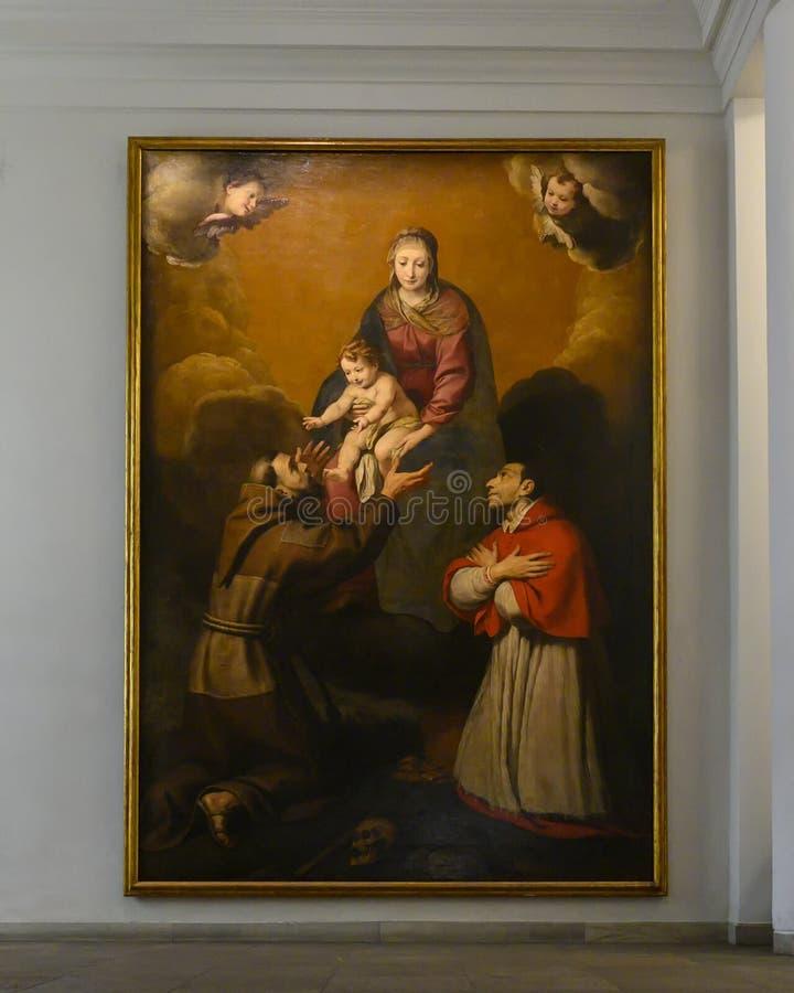 Madonna e bambino e san adorare nel Pinacota Ambrosiana, la galleria di arte ambrosiana a Milano, Italia fotografia stock libera da diritti