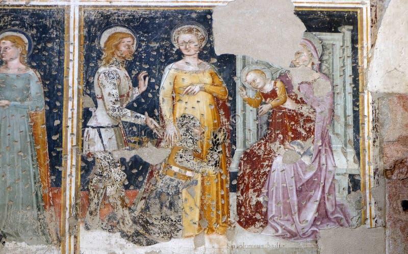 Madonna e criança entronizada, St George, Saint e um cavaleiro do worshipper fotografia de stock