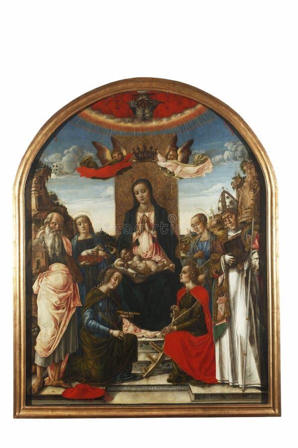 Madonna ed il bambino sul trono hanno incoronato da due angeli, con Dio il padre ed i san immagini stock