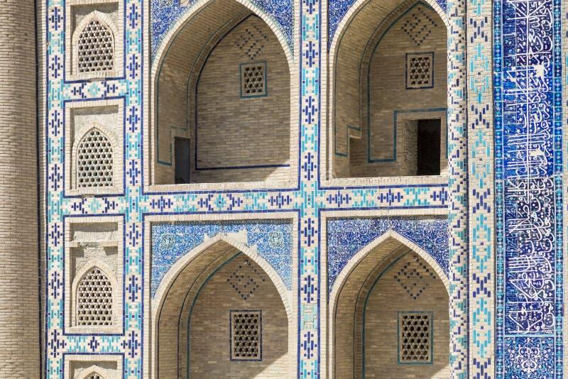 Madrasa facade in Bukhara, Uzbekistan.Traditional architecture. stock photos
