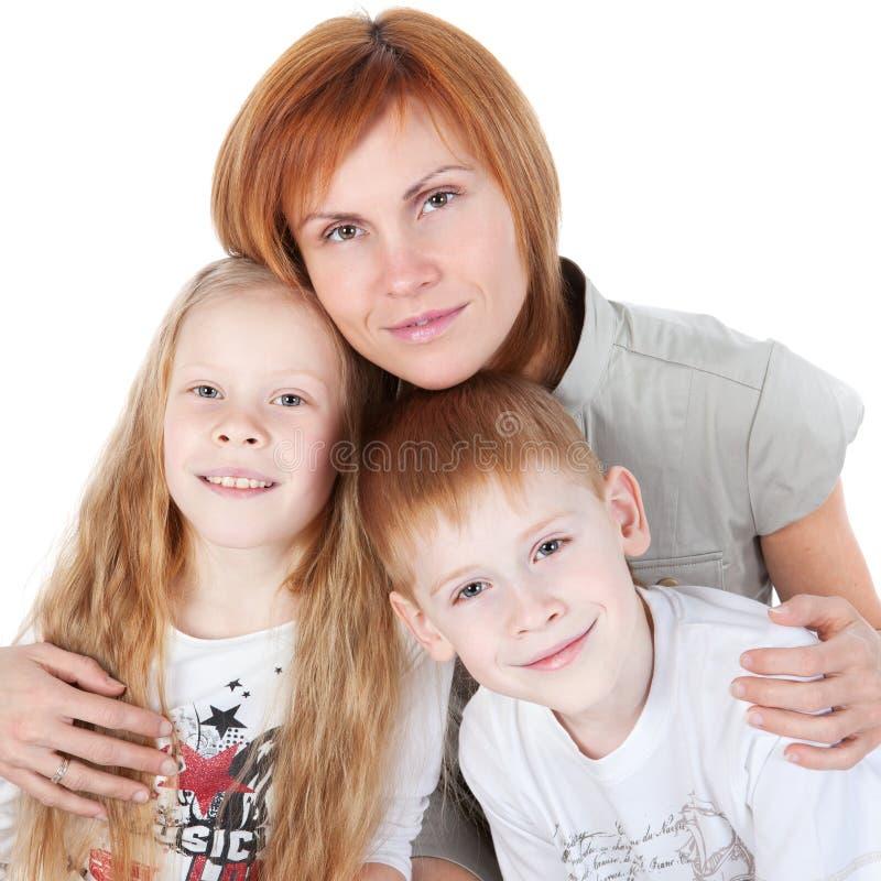 Madre con i bambini sopra bianco fotografie stock