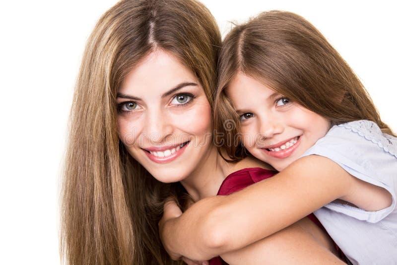 Download Madre e hija foto de archivo. Imagen de kissing, lifestyle - 44852872
