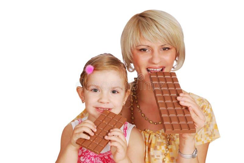 Madre e hija con el chocolate fotografía de archivo