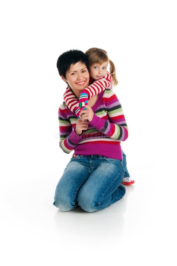 Madre e hija en blanco imagen de archivo