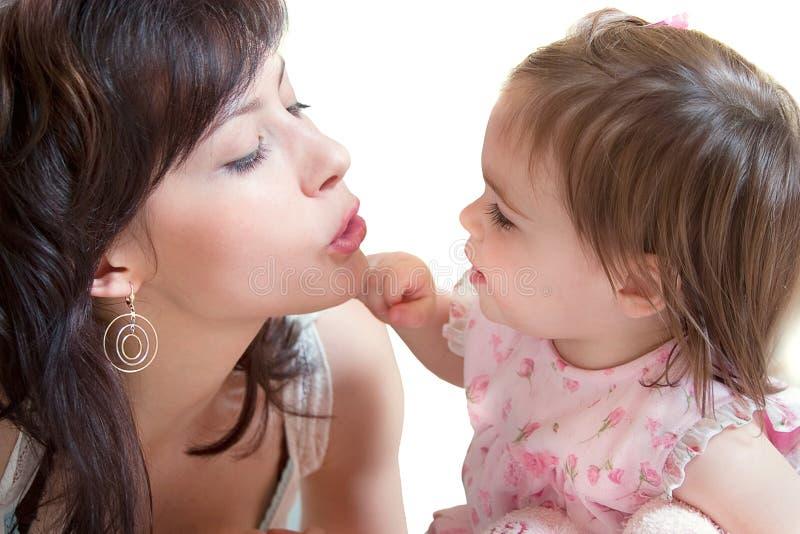 Madre e piccola figlia fotografia stock