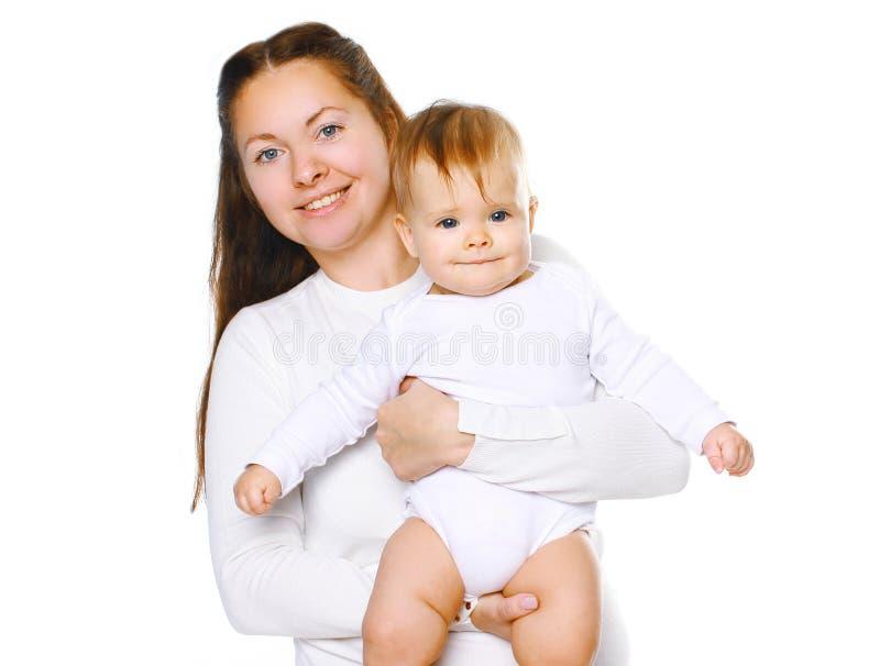 Madre felice che tiene bambino sveglio fotografie stock