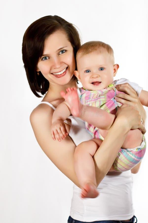 Madre felice con il piccolo bambino immagine stock libera da diritti