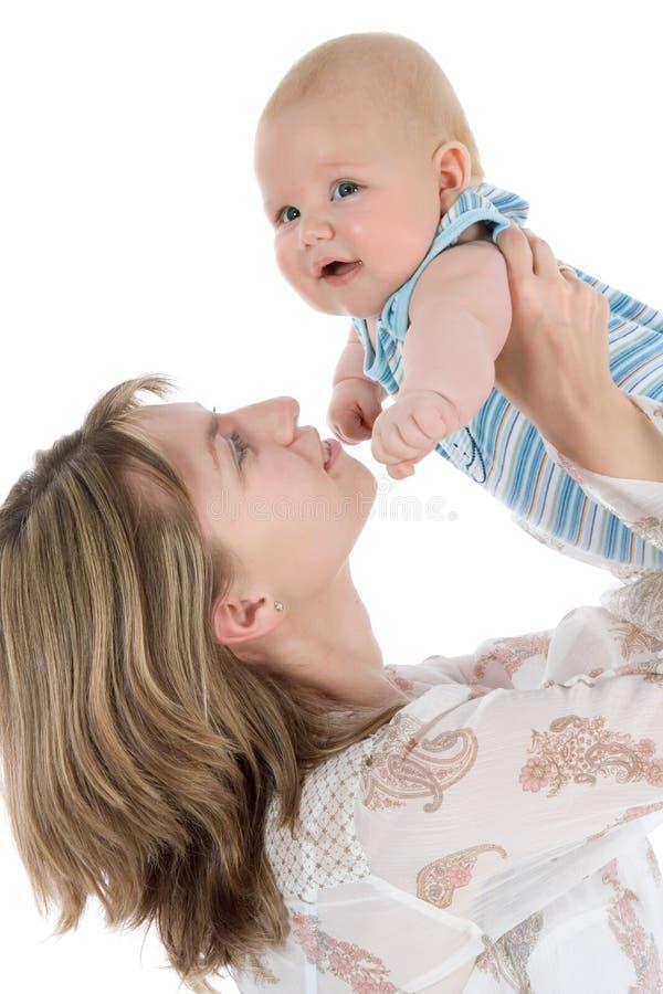 Madre feliz con el bebé imagen de archivo