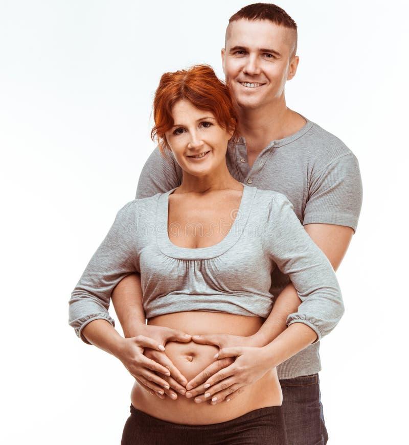 Madre incinta e padre felice fotografia stock