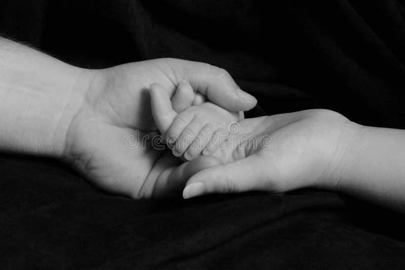 Madre, padre y bebé imágenes de archivo libres de regalías
