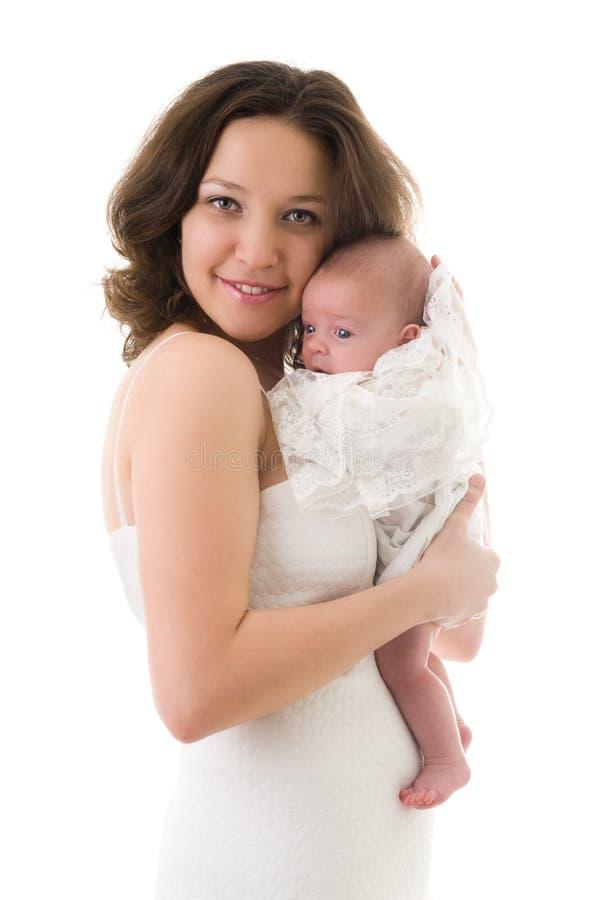 Madre sonriente con el bebé imágenes de archivo libres de regalías