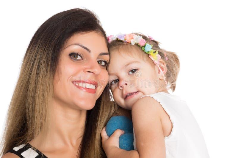 Madre sorridente felice con la figlia fotografia stock