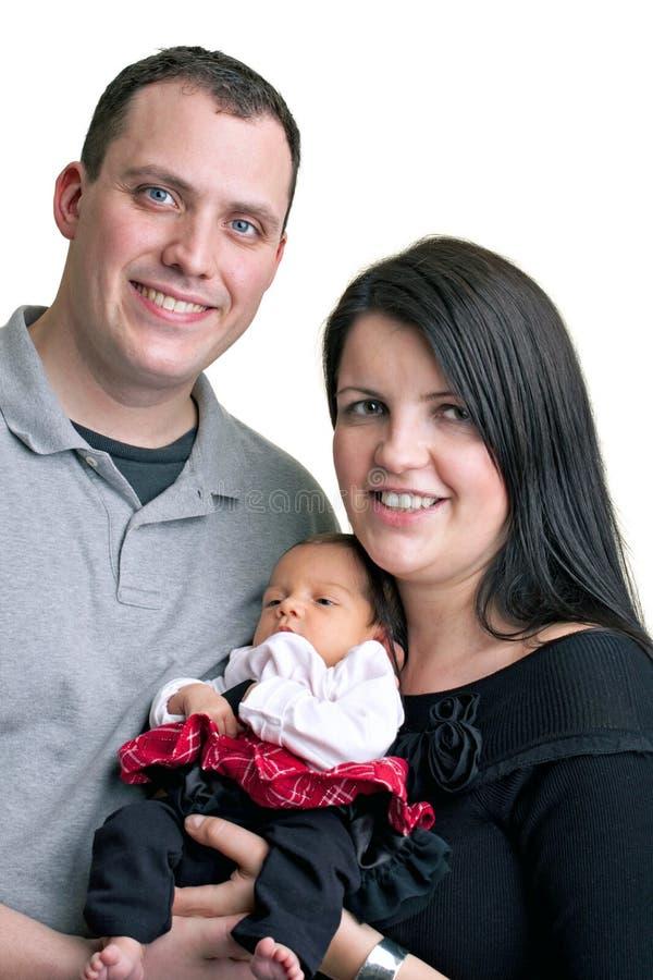 Madre y padre con su bebé fotos de archivo libres de regalías