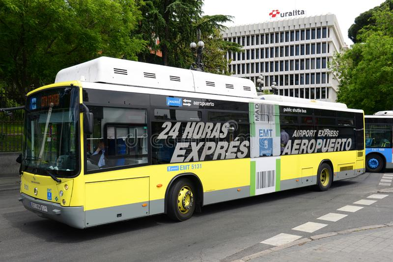 Madrid EMT urban bus in Madrid, Spain. Madrid Airport Express Bus on Paseo de Recoletos in Madrid, Spain stock images