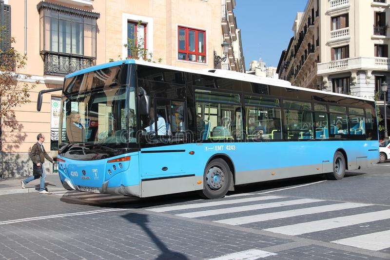 Madrid bus. MADRID - OCTOBER 22: People ride city bus on October 22, 2012 in Madrid. EMT is Madrid's main bus operator. It uses fleet of more than 2000 buses and royalty free stock photos