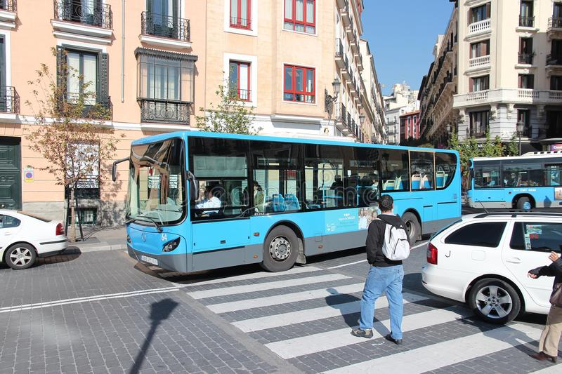 Madrid bus. MADRID, SPAIN - OCTOBER 22, 2012: People ride city bus in Madrid. EMT is Madrid's main bus operator. It uses fleet of more than 2000 buses and serves stock photography