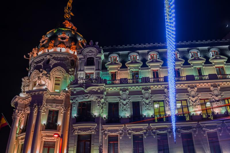 Madrid at Christmas. Night view of the Metropolis building of Ma stock photography